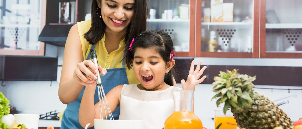 child happy to cook with mum